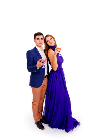 Young couple celebrating with cocktails isolated photo