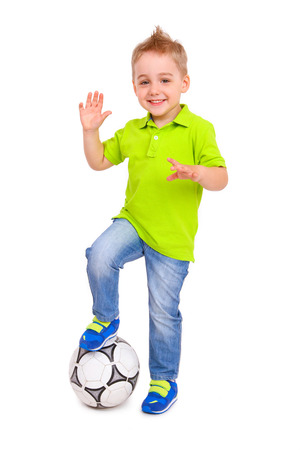 Happy little boy with a soccer ball isolated