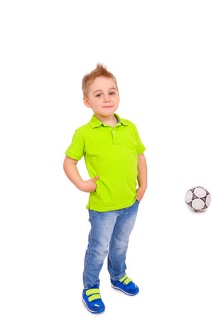 Smiling little boy with a soccer ball isolated photo
