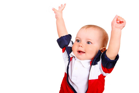 child boy with hands up isolated on a white background photo