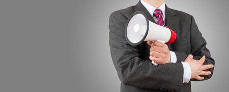 business man holding megaphone with copy space