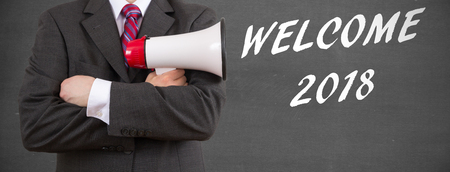 businessman holding megaphone - Welcome 2018! Stock Photo
