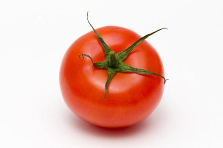 big red tomato on white background Stock Photo