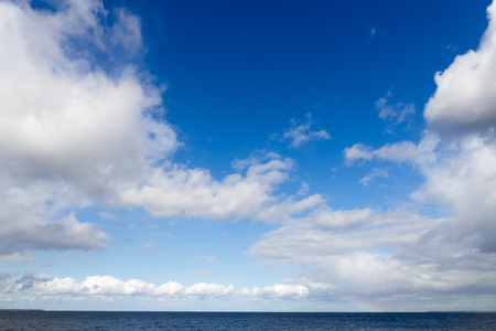 Sea with blue sky and white clouds Stock Photo