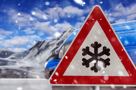 traffic sign snow with road and driving truck Stock Photo