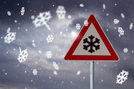 traffic sign snow with dark sky and snowflakes