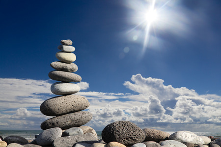 stack of zen stones over sea and clouds background Stock Photo