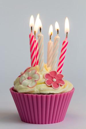 Pink birthday cupcake Stock Photo