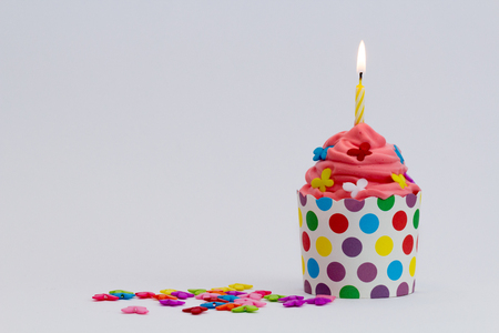 Colorful birthday cupcake Stock Photo