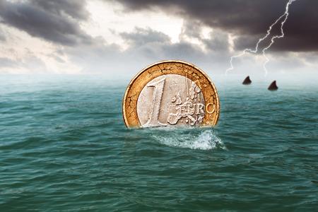 swimming euro coin Stock Photo