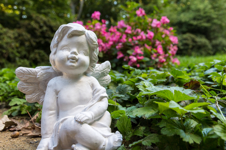 Angel figure with flowers