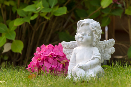 Angel figure with flower Stock Photo