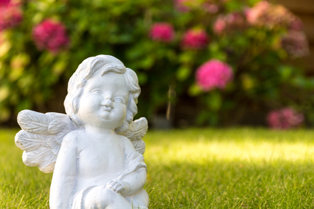 angel with flowers Stock Photo