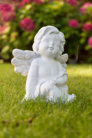 white angel figure with flowers