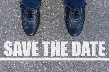 Top View of Business Shoes on the floor with the text: Save the date