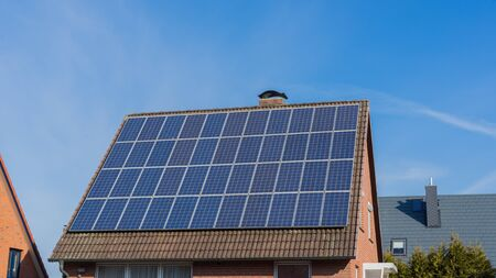 House with solar panels on the roof Stock Photo