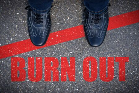 Top view of business shoes on the floor with the text: Burn Out