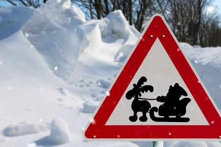 Red road sign with Santa Claus in the snow