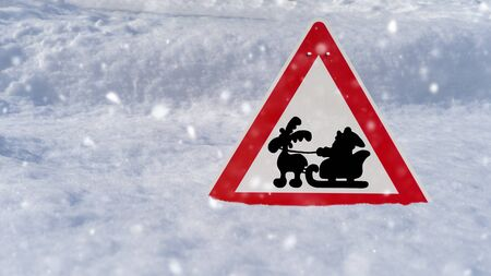 Red road sign with Santa and reindeer in the snow