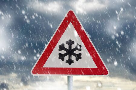 winter driving - warning sign - risk of snow and ice