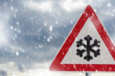 Traffic sign and heavy snowfall on a country road