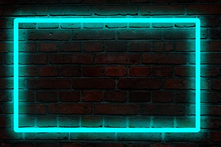 Green neon light frame on a dark brick wall