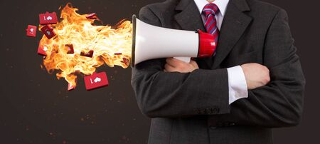 Business man holding megaphone on fire with red hot likes