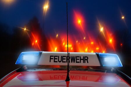 German fire car on the road at night