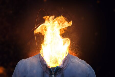 Stressed young man with fire head. Stock Photo - 139945712