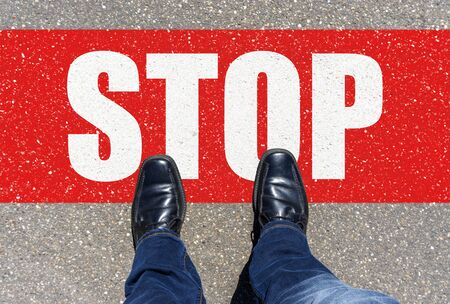 Man standing on a stop sign. top view Stock Photo - 141848176