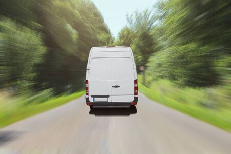 Van driving on country road Stock Photo