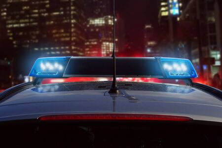 Police car at night on the road. Stock Photo