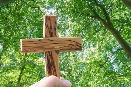 Man holding wooden cross Stock Photo