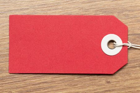 Red tag on wooden background Stock Photo
