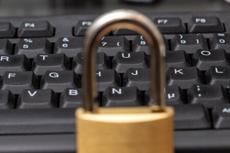 Padlock and Computer Keyboard, symbolic photo for data security Stock Photo