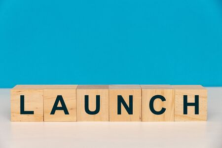 Launch Word Written On Wood Cube Stock Photo - 140894790