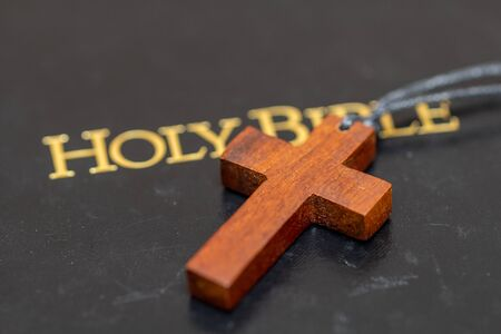 Wooden Cross on Bible Stock Photo