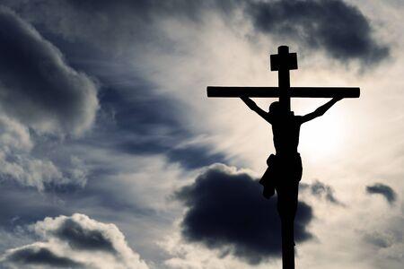 Silhouette of Jesus with Cross Foto de archivo