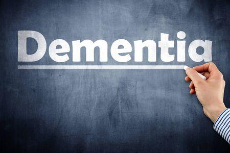 Dementia word written on blackboard