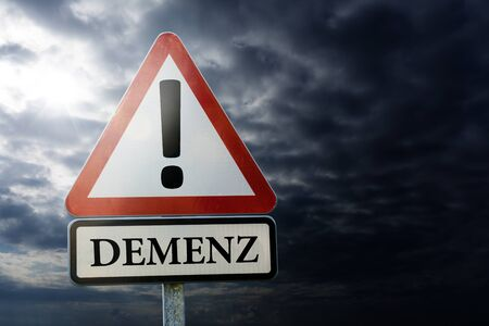 Dementia, Alzheimer's, Forgotten - road sign against a dark cloudy sky