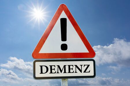Dementia, Alzheimer's, Forgotten - road sign against a blue sky with the sun