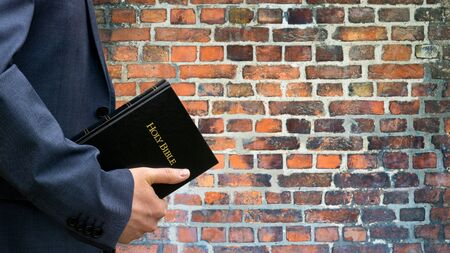 Man holding bible in his hand. Concept for faith, spirituality and religion.