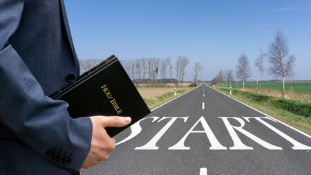 Man holding bible in his hand. Concept for faith, spirituality and religion