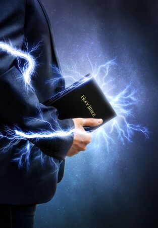 Man holding his powerful Bible Stock Photo