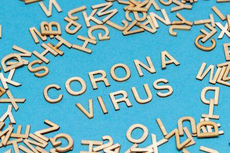 Wooden letters CORONAVIRUS on blue background Stock Photo