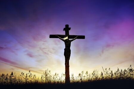 Jesus Christ death on cross crucifixion on calvary hill at sunrise
