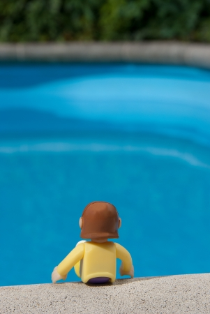 soggy: doll sitting in a pool of water Stock Photo