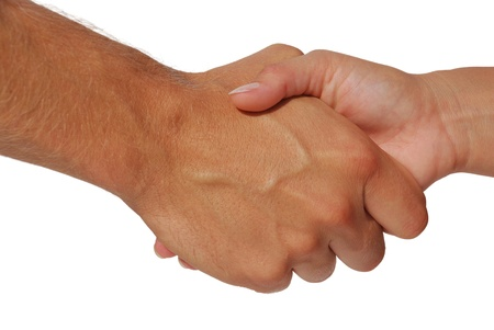 A man and a woman shake hands in agreement. photo