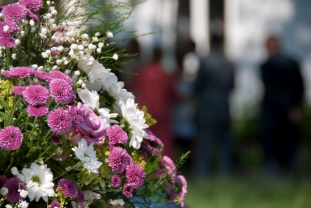 funeral: Bouquet of flowers at a funeral or wedding.