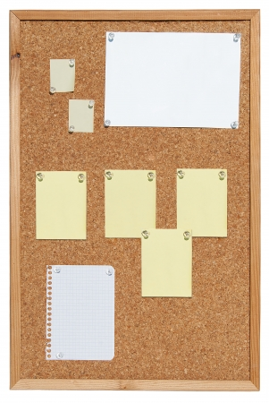 Cork bulletin board with notes on slips of paper. photo